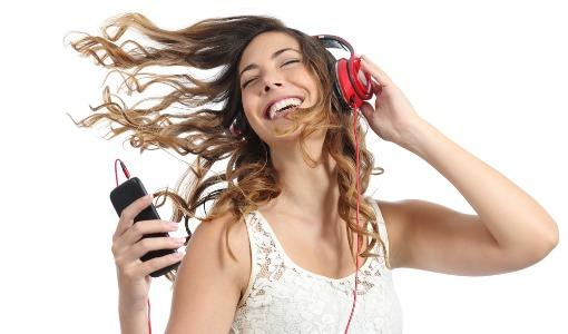 woman-listening-to-music-headphones-smartphone-shutterstock-510px.jpg